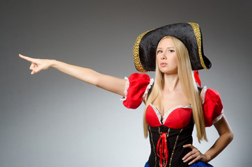 Woman pirate against grey background