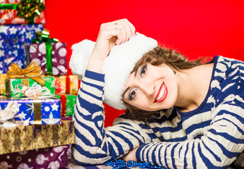 lovely smiling brunet in striped sweater with presents