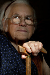 Portrait of a senior lady resting on the walking stick