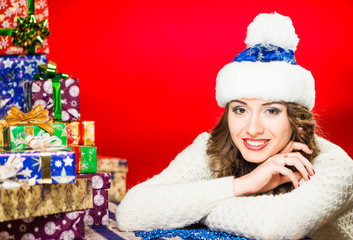 young smiling brunet  portrait with holiday presents