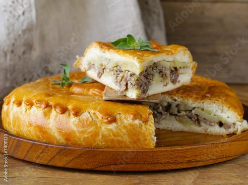 canvas print picture homemade meat pie with potatoes and oregano
