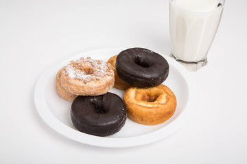 Variety of Donuts on White Plate