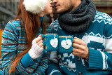 Fototapety Couple with coffee cups in winter