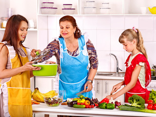 Family with grandmother and child at kitchen.