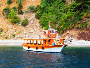 Orange yacht in deserted bay, Turkey