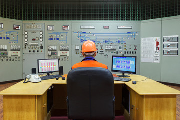 Engineer sitting at workplace