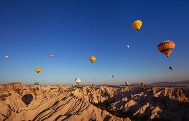 beautiful landscape with hot air balloons and mountains