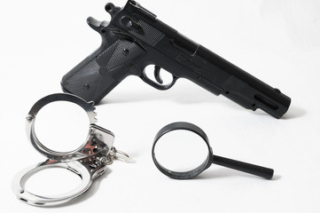 Weapon Crime Concept Gun and Handcuffs