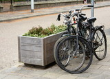 Two parked bicycles on the street in Dutch city