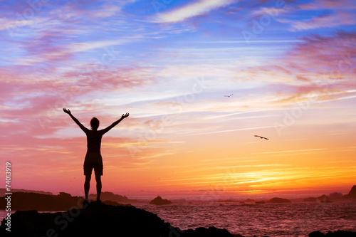 silhouette of woman with raised hands - 74013919