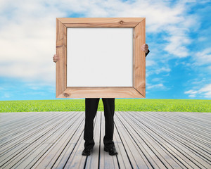 man holding blank white board with wooden frame