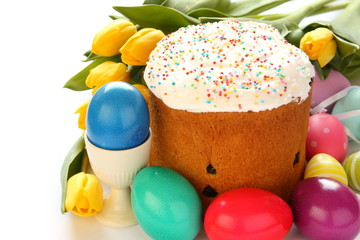 Easter bread, colorful eggs and yellow tulips