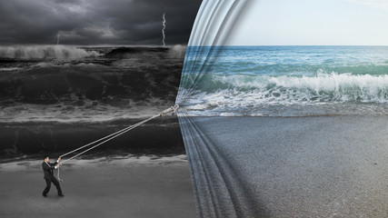 businessman pulling open calm sea curtain covered dark stormy oc