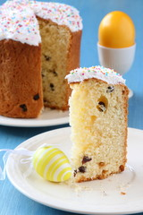 Slice of easter bread with colorful eggs and yellow