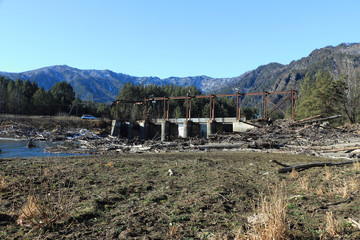 The destroyed bridge among mountains