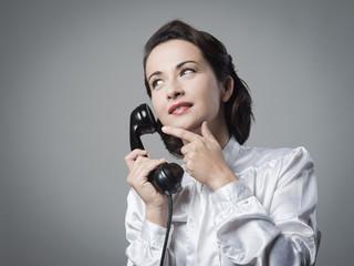 Pensive vintage secretary on the phone