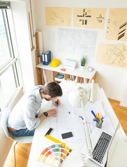 Young architect at his studio