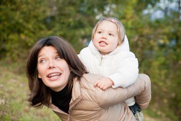 piggyback ride of little daughter