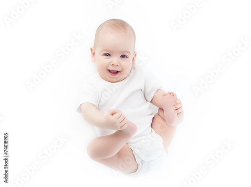 Baby lying on the white background - 74018906