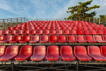 Empty plastic chairs at temporary grandstand stadium in Phuket,