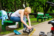 Attractive woman putting on roller blades