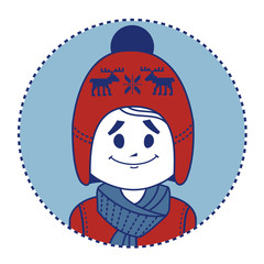 Smiling boy dressed in red knitted hat with deers and scarf