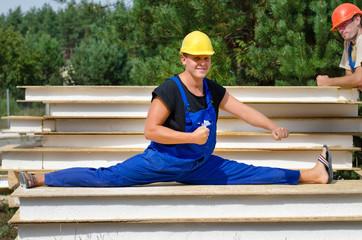 Funny fit worker in side split position at work