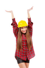 young woman worker in red shirt and yellow helmet with raised ha
