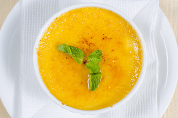 Bowl of pumpkin soup with mint