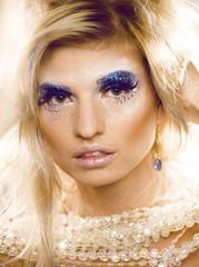 beauty blong woman ith make up, winter tinsel shining