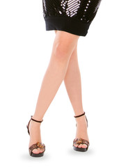 Long female legs in high shoes over white