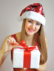 Portrait of beautiful sexy girl with Christmas gift