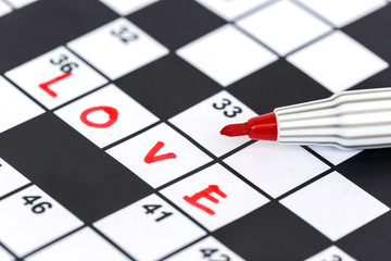 Close up red marker on Crossword - Love