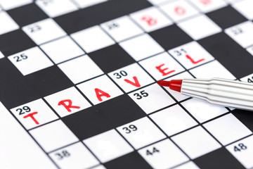 Close up red marker on Crossword - Travel