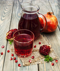 Pitcher and glass of pomegranate juice