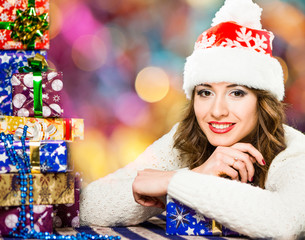 smiling woman in red hat with gifts at colorful background