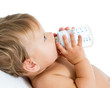 baby holding bottle and drinking