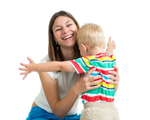 Young mother hugging kid