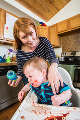 Woman Feeds Her Gumpy Baby