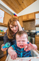 Woman Feeds Gumpy Baby