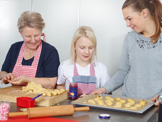 Family baking Christmas biscuits