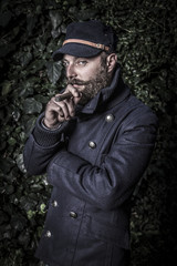 portrait of a stylish man with beard, hipster sailor style