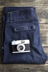 Detail of vintage jeans with classic camera