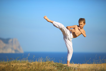 boy karate on the coast