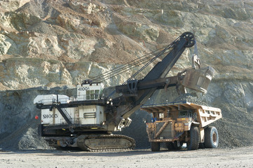 Loading heavy dump truck at the opencast mining