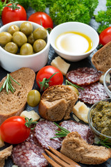 cheese, salami and various Italian appetizer, vertical