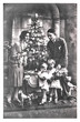 family portrait of parents and children with christmas tree