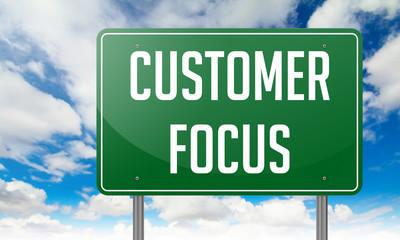 Customer Focus on Highway Signpost.