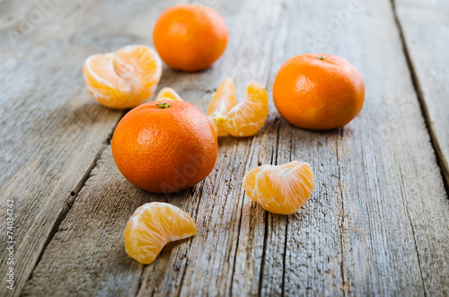 canvas print picture Ripe tasty tangerines on wooden background