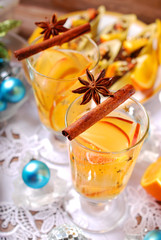 apple and orange drink with spices for christmas
